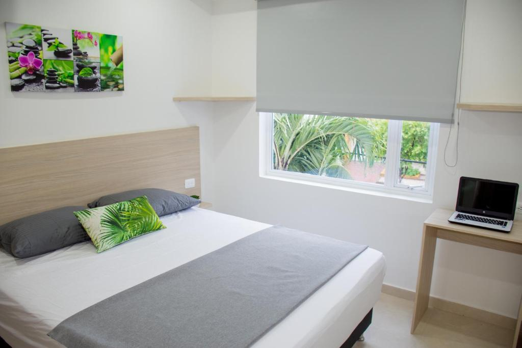 A bed or beds in a room at Stanza Hotel Monteria