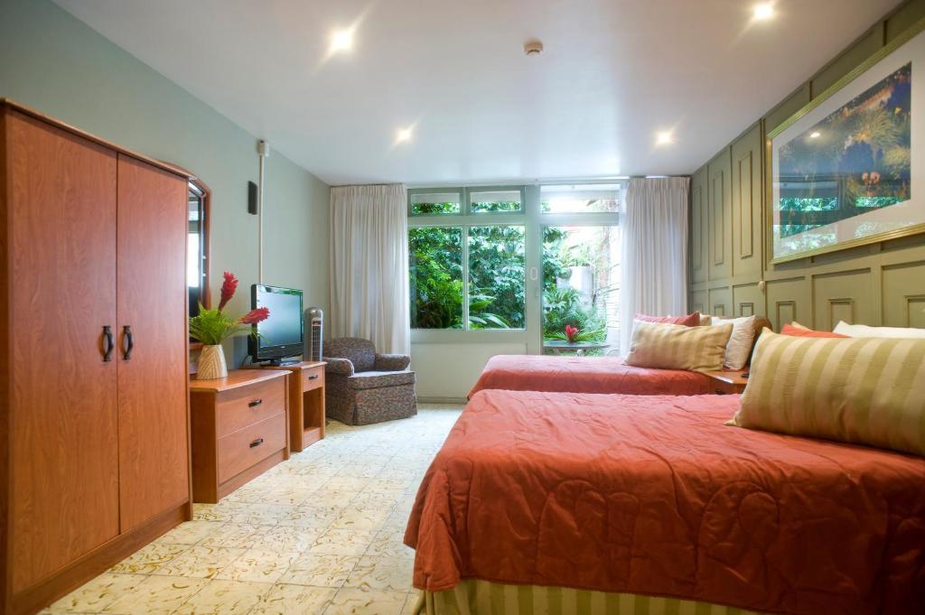 En eller flere senge i et værelse på Hotel Aranjuez