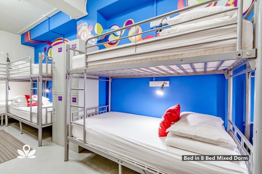 A bunk bed or bunk beds in a room at ZEN Hostel Bugis
