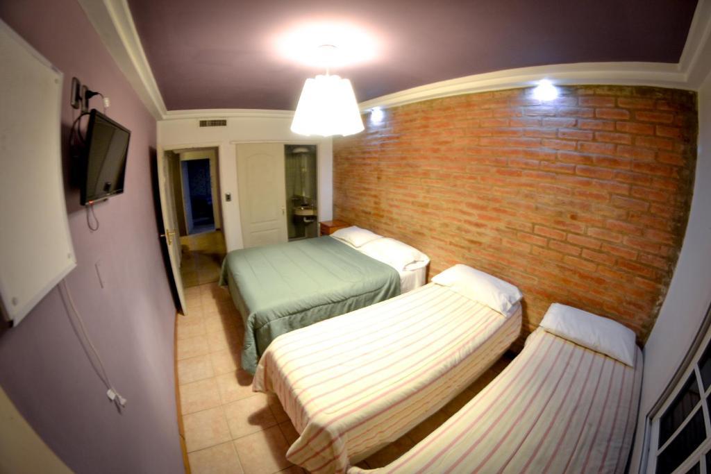 A bed or beds in a room at Hotel Cuesta del Viento