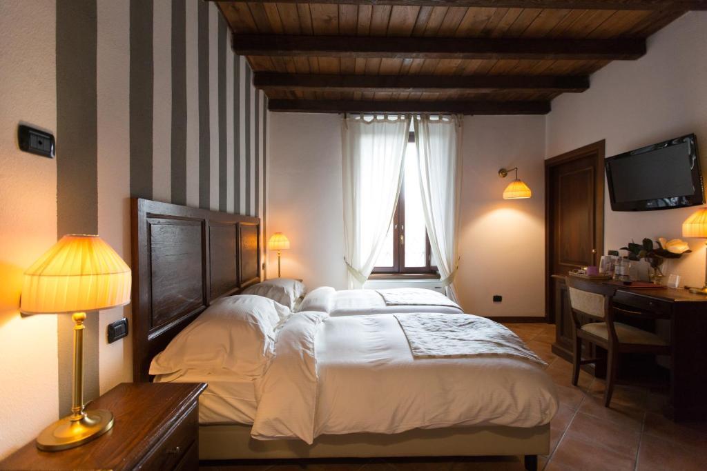 Letto o letti in una camera di Hotel Tenimento Al Castello