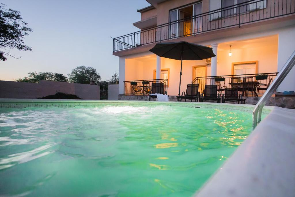 The swimming pool at or near Apartments Joy