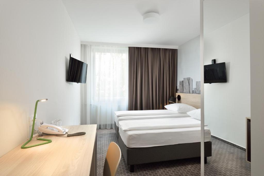 Postelja oz. postelje v sobi nastanitve B&B Hotel Ljubljana Park