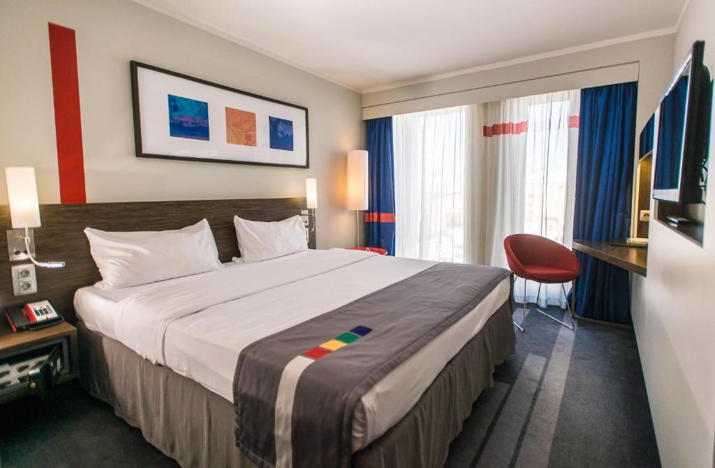 Кровать или кровати в номере Piter Inn