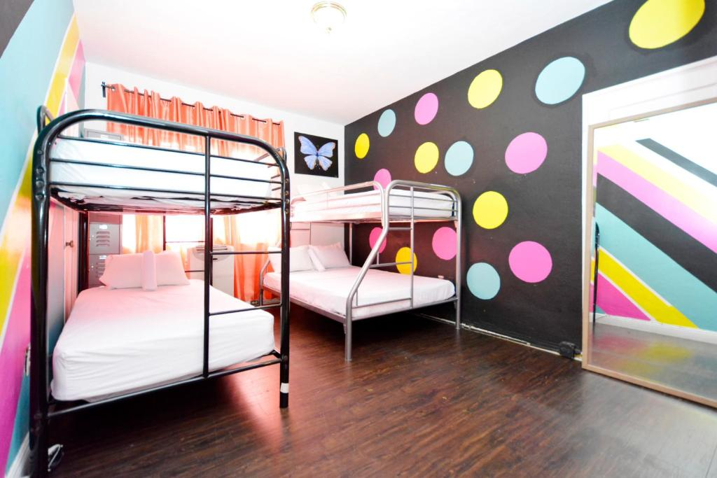 A bunk bed or bunk beds in a room at South Beach Rooms and Hostel