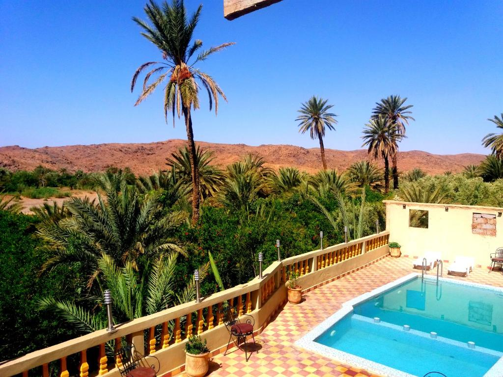 A view of the pool at Kasbah Elmehdaoui Chez Madame Najate or nearby