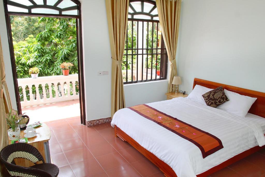 Giường trong phòng chung tại Tam Coc Dream Hotel