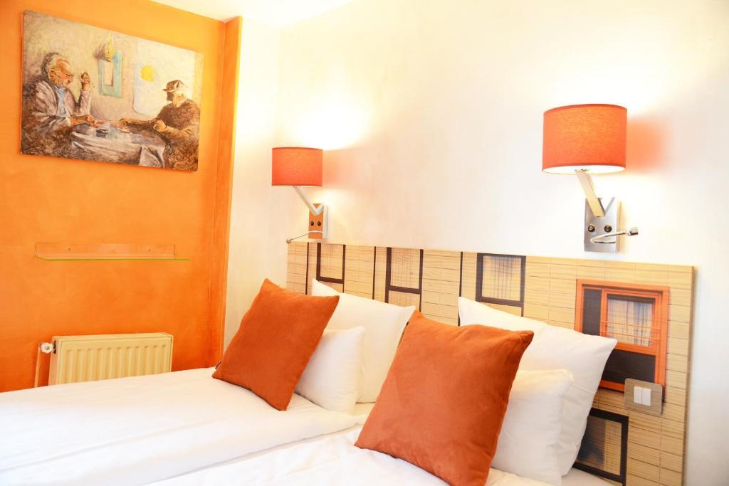 Кровать или кровати в номере Hôtel Malar