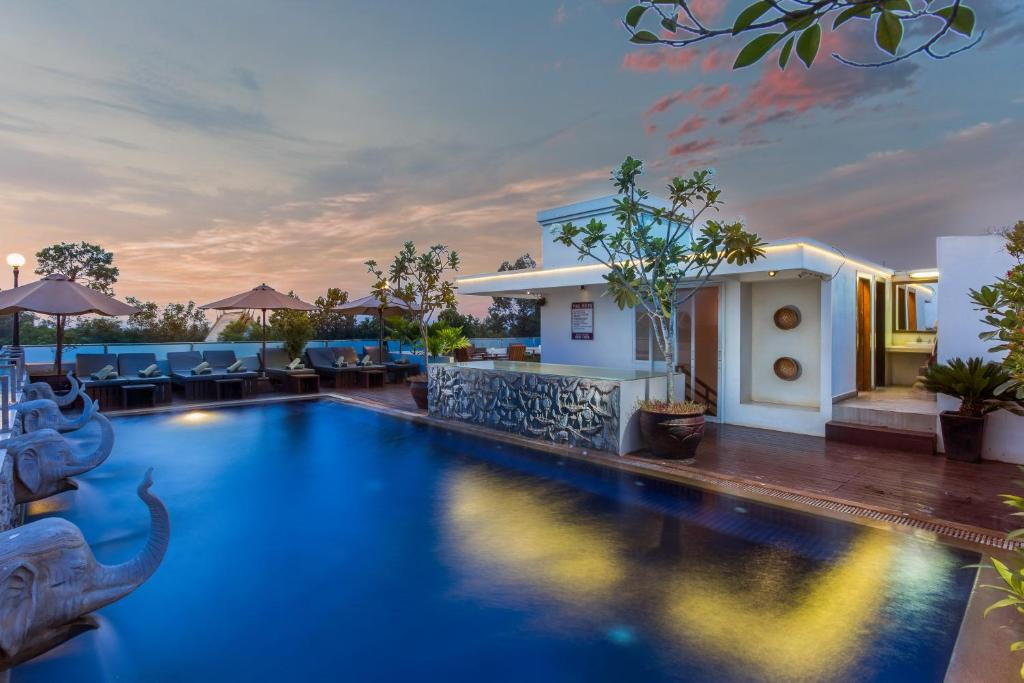 The swimming pool at or close to Nita by Vo Luxury Hotel