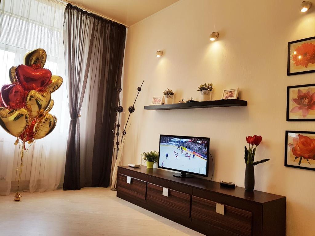 Телевизор и/или развлекательный центр в Апартаменты Зефир на Нахимова