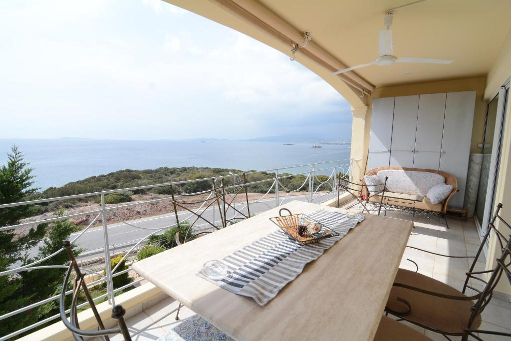 A balcony or terrace at view of the sea