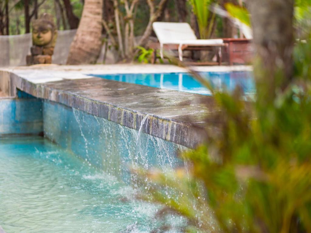 Der Swimmingpool an oder in der Nähe von Le Domaine De Tam Hai Resort