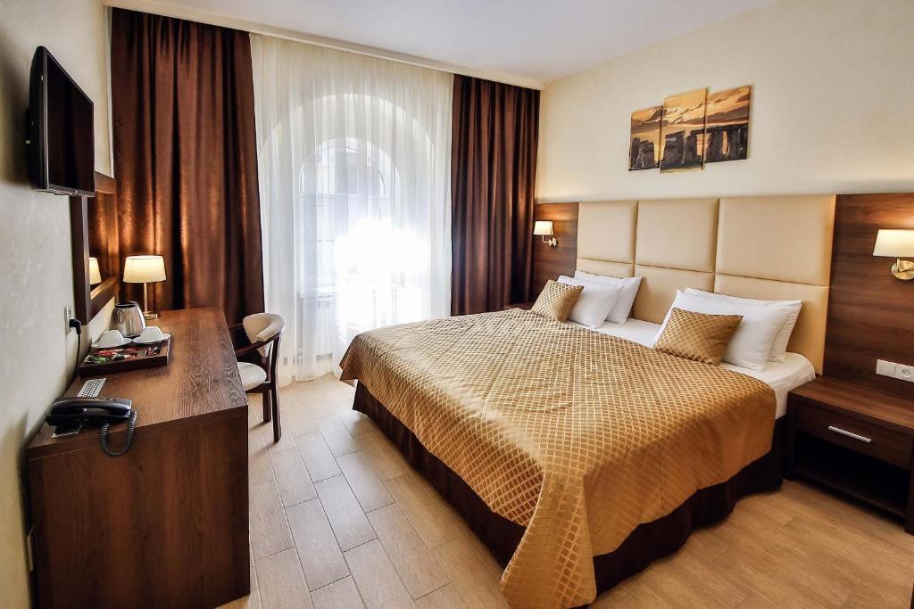 Кровать или кровати в номере Гостевой Дом Колибри