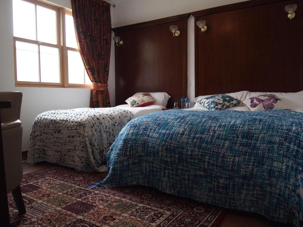 A bed or beds in a room at The Nore River House