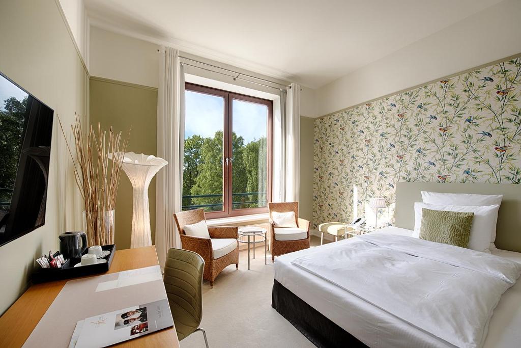 Ein Bett oder Betten in einem Zimmer der Unterkunft Privathotel Lindtner Hamburg