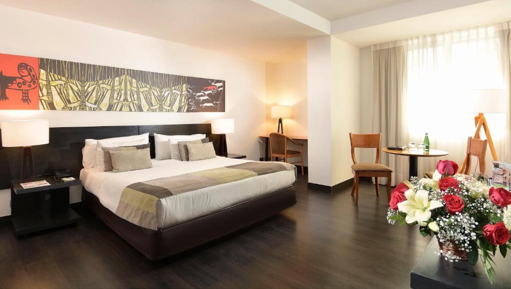 Cama o camas de una habitación en Hotel Eurotel Providencia