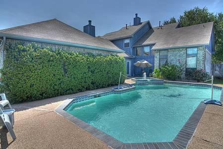 The swimming pool at or near Bedroom With Private Bathroom and Garage
