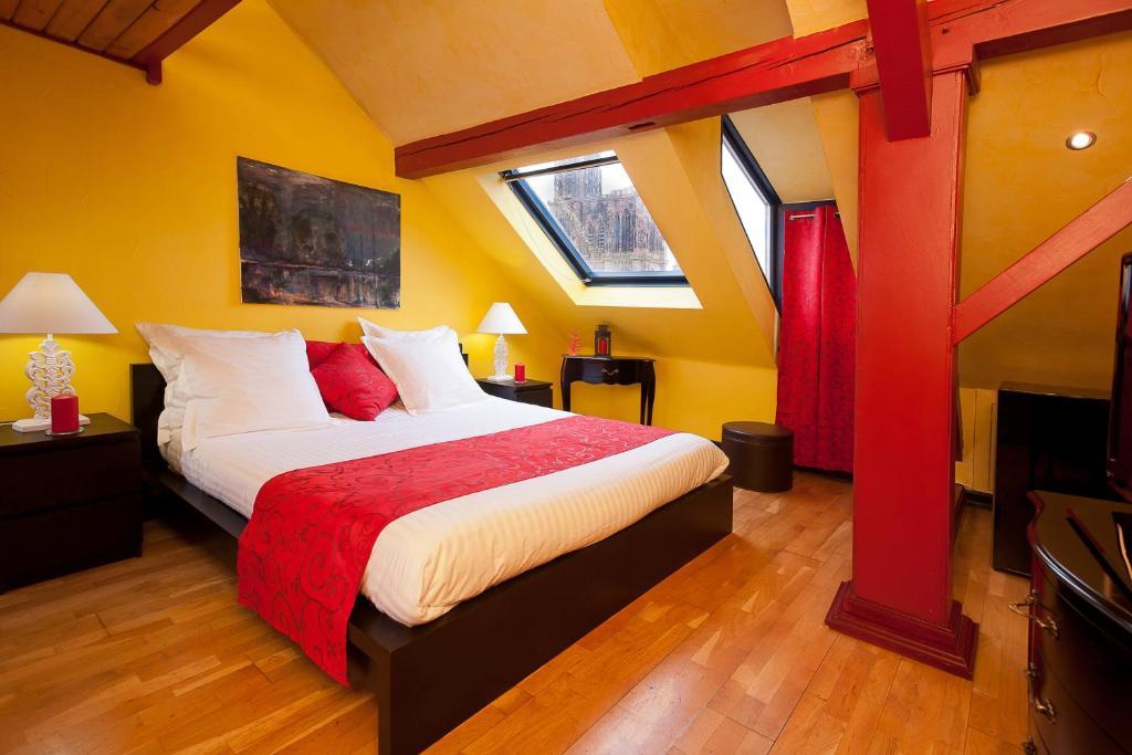 Кровать или кровати в номере Le Loft 13