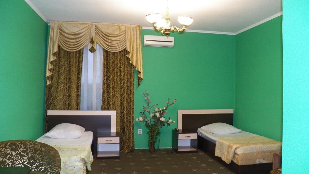 Кровать или кровати в номере Отель Индиго
