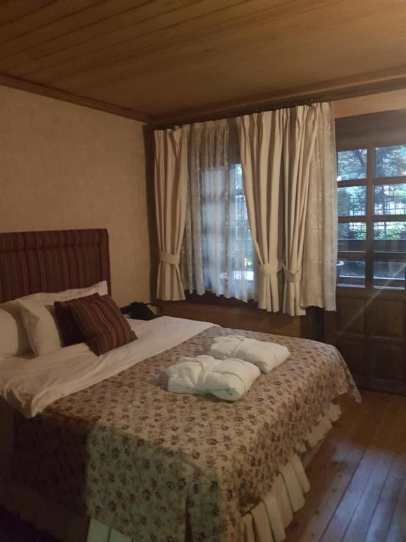 Lova arba lovos apgyvendinimo įstaigoje Royal Uzungol Hotel&Spa