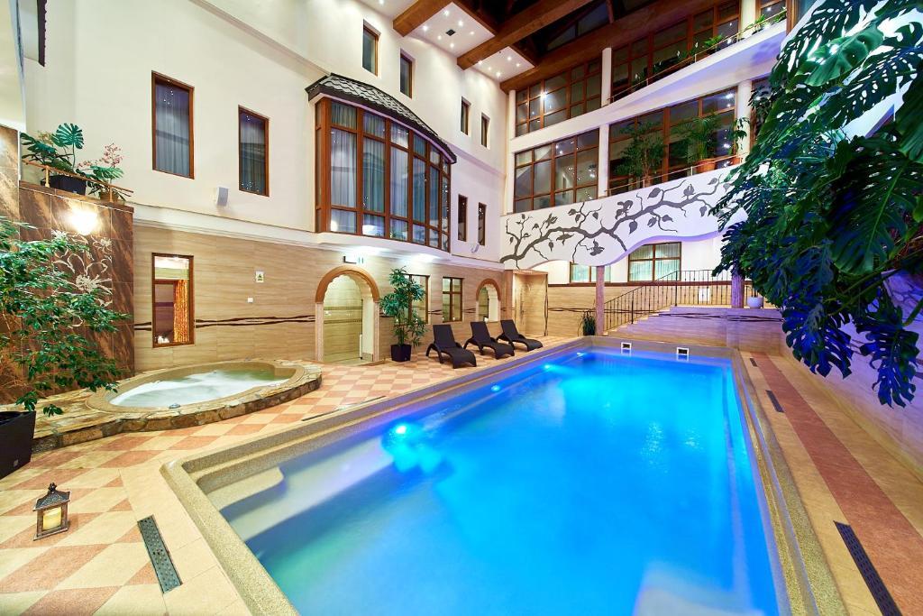 The swimming pool at or near Kinga Hotel Wellness
