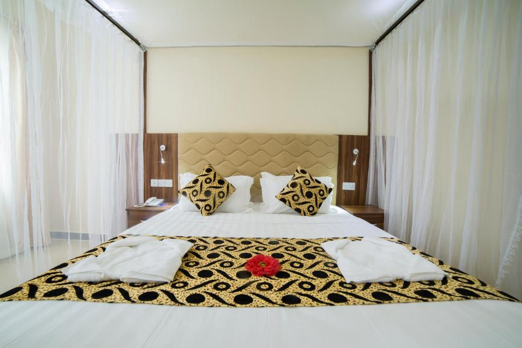 A bed or beds in a room at Spice Palace Hotel