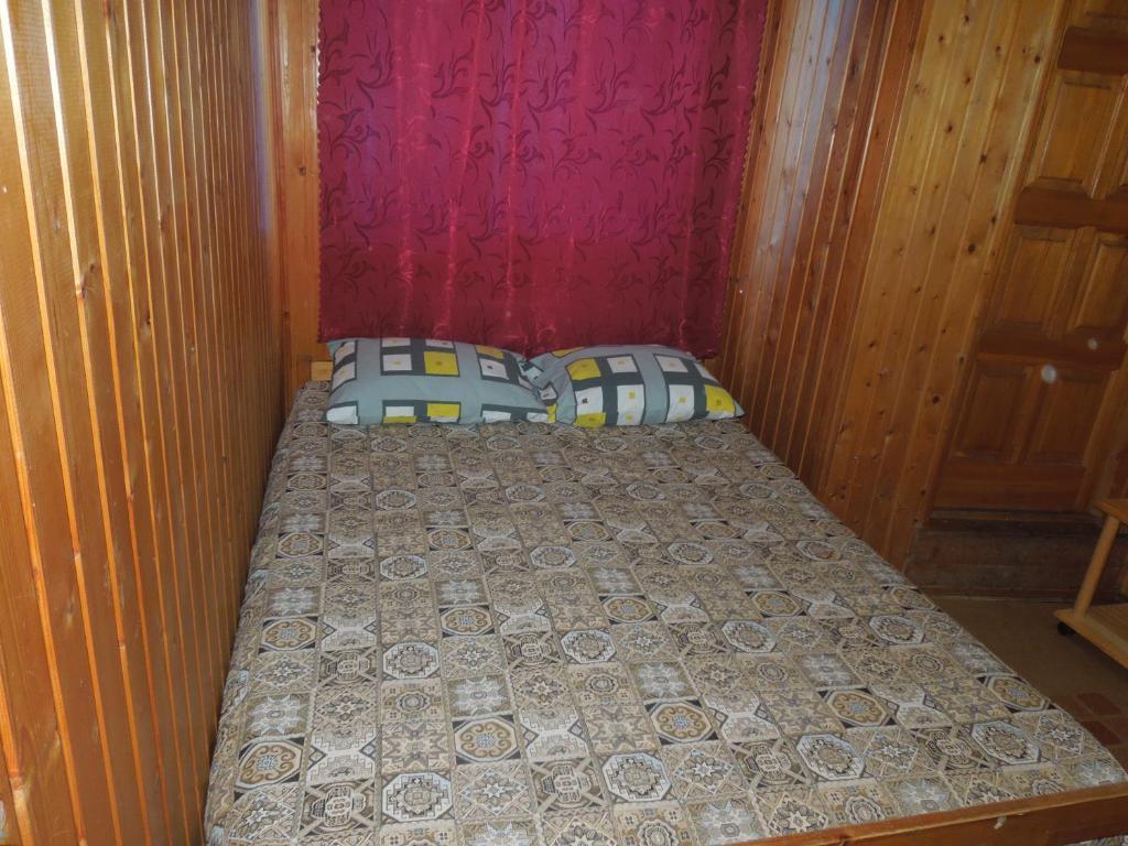 Кровать или кровати в номере Guest House Avangard