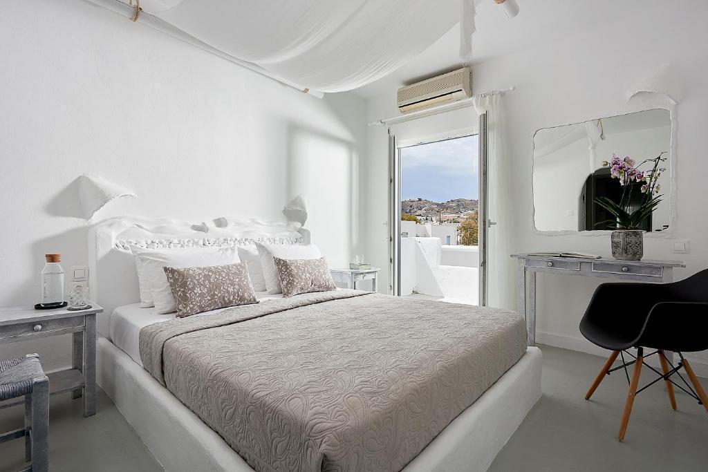 米洛斯酒店房間的床