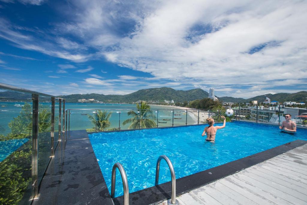 The swimming pool at or near Patong Signature Boutique Hotel