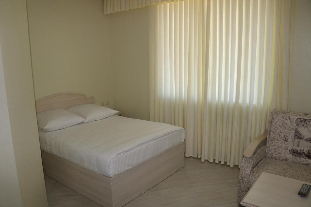 Двухместный номер с двуспальной кроватью и дополнительной кроватью: фотография номер 10