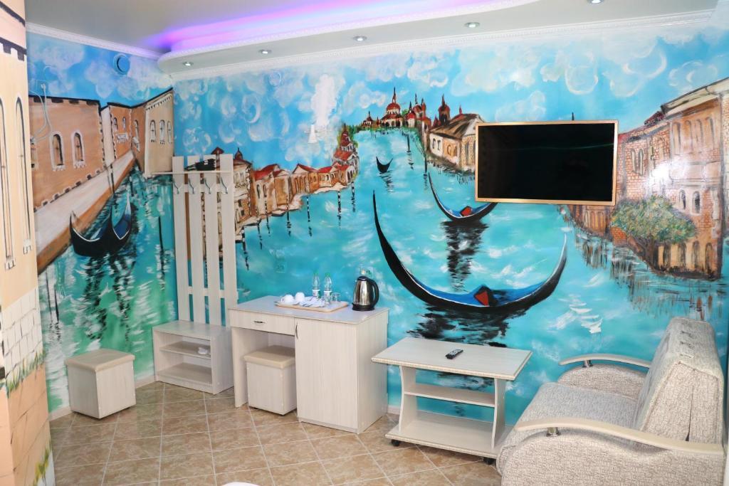 Телевизор и/или развлекательный центр в Hotel Zamok Korolya