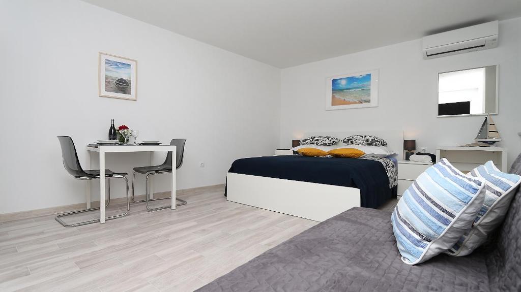 Postel nebo postele na pokoji v ubytování Modern Apartments Iva