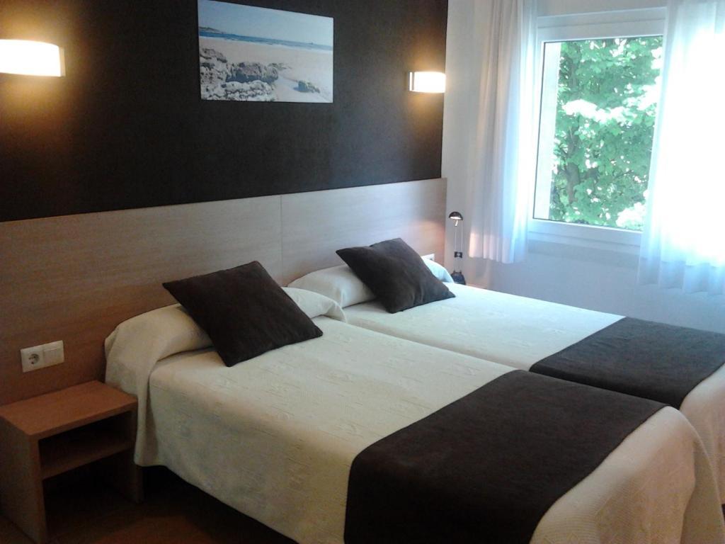 Letto o letti in una camera di Hostal Rocamar