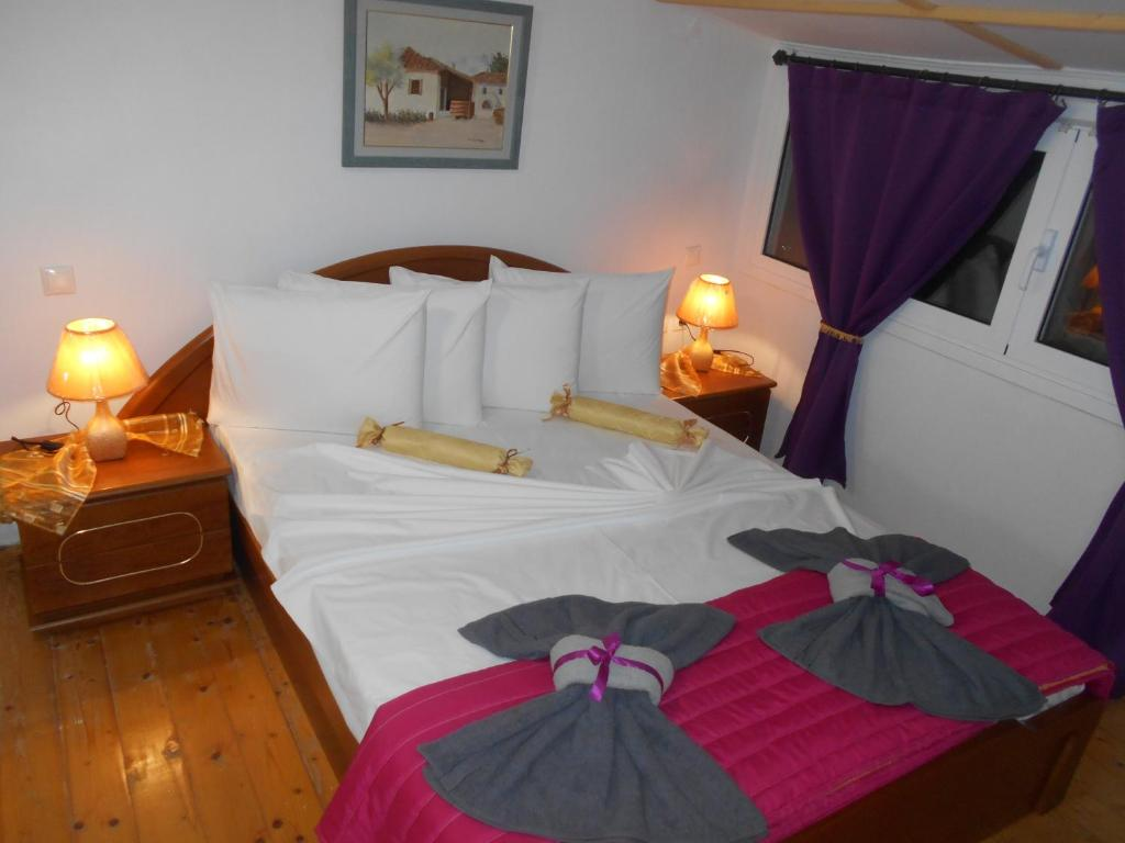 A bed or beds in a room at Happy Owl Village