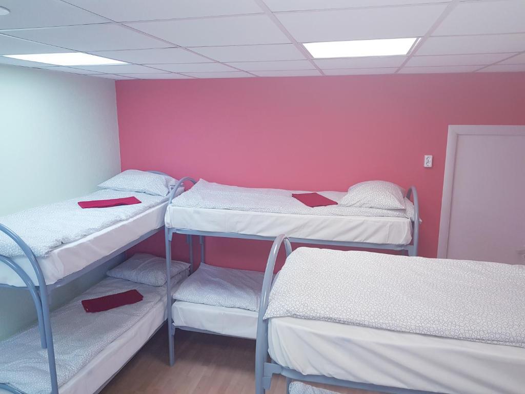 Двухъярусная кровать или двухъярусные кровати в номере Радуга