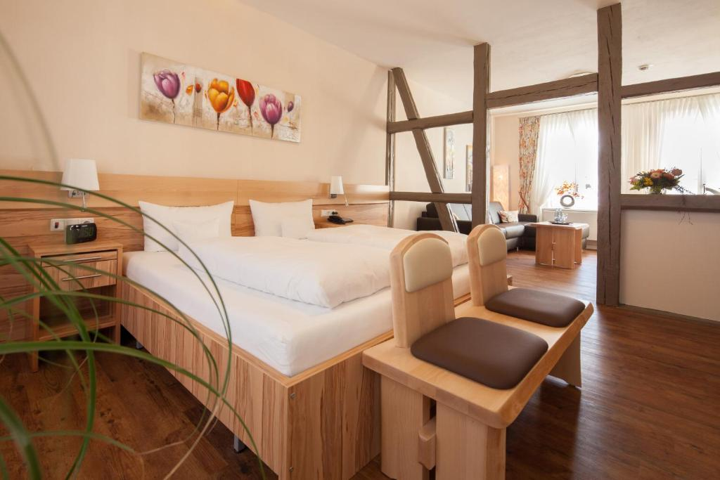 A bed or beds in a room at GDA Hotel Schwiecheldthaus