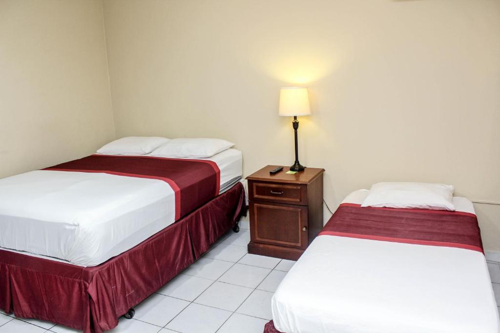 Cama o camas de una habitación en Coconut Inn