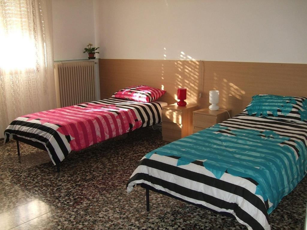 A bed or beds in a room at Venice Lagoon House B&B