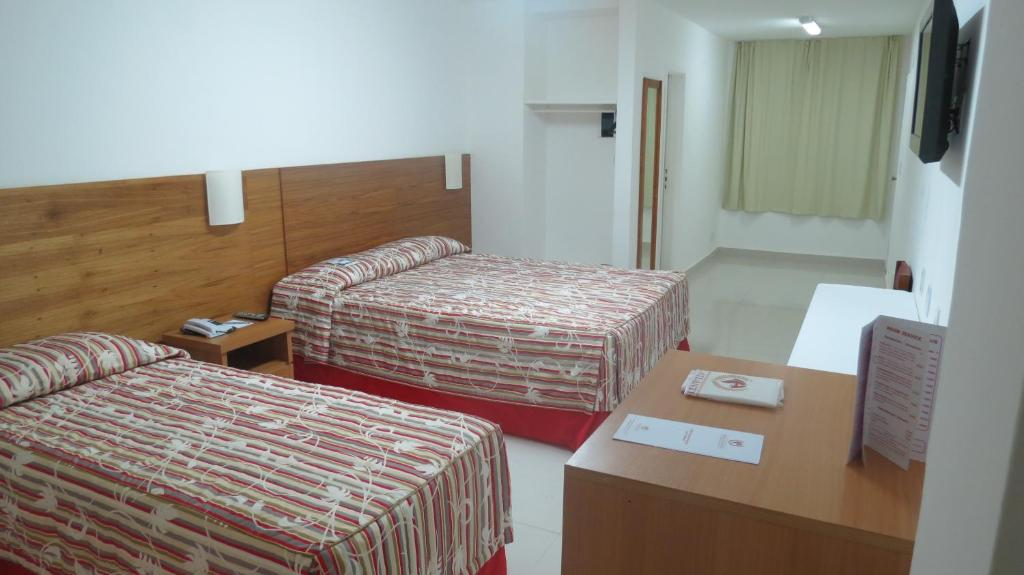 A bed or beds in a room at Atlântico Centro Apartments