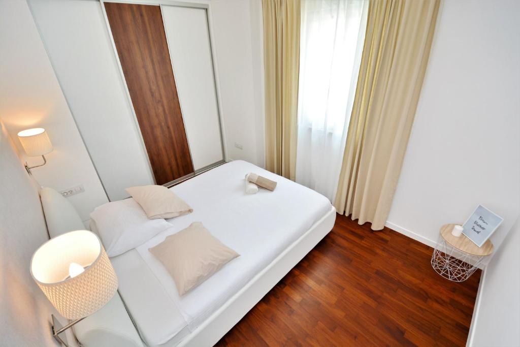 A bed or beds in a room at Luxury apartment Leon