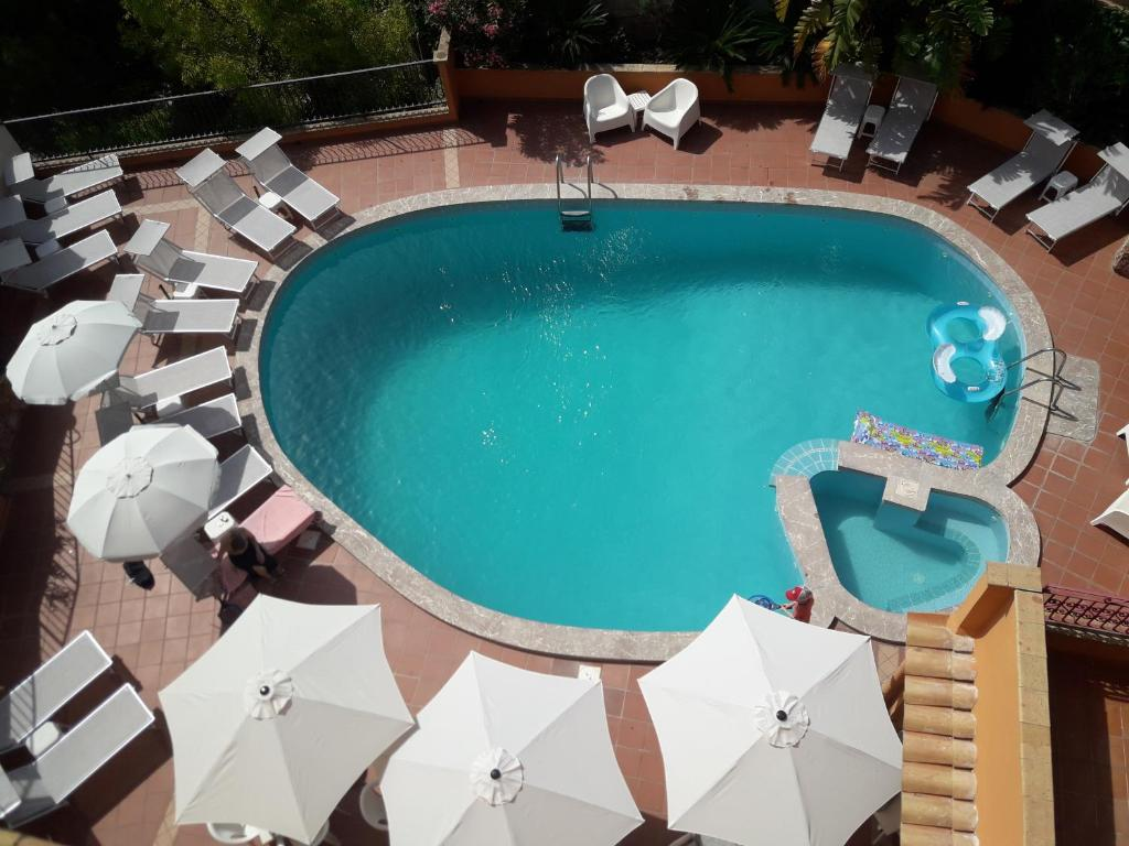 A view of the pool at Andromaco Palace Hotel or nearby