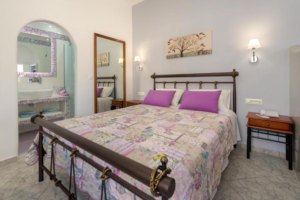 A bed or beds in a room at Akis Hotel