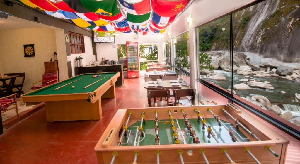 A pool table at Casa Machu Picchu Hostel
