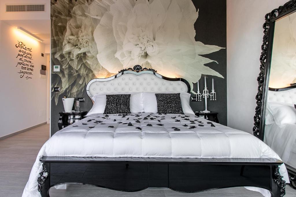 سرير أو أسرّة في غرفة في Bellavistarelax