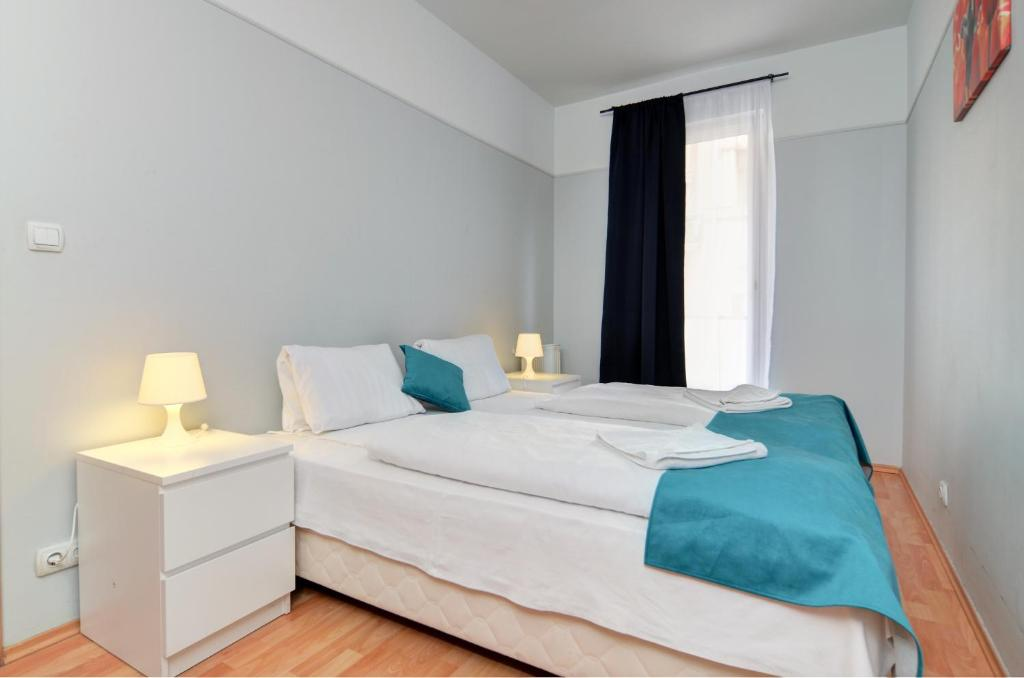A bed or beds in a room at Agape Apartments