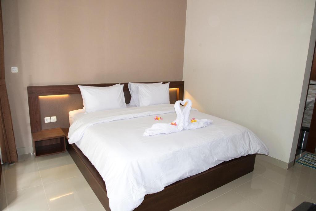 Postel nebo postele na pokoji v ubytování Rare Bali Guest House