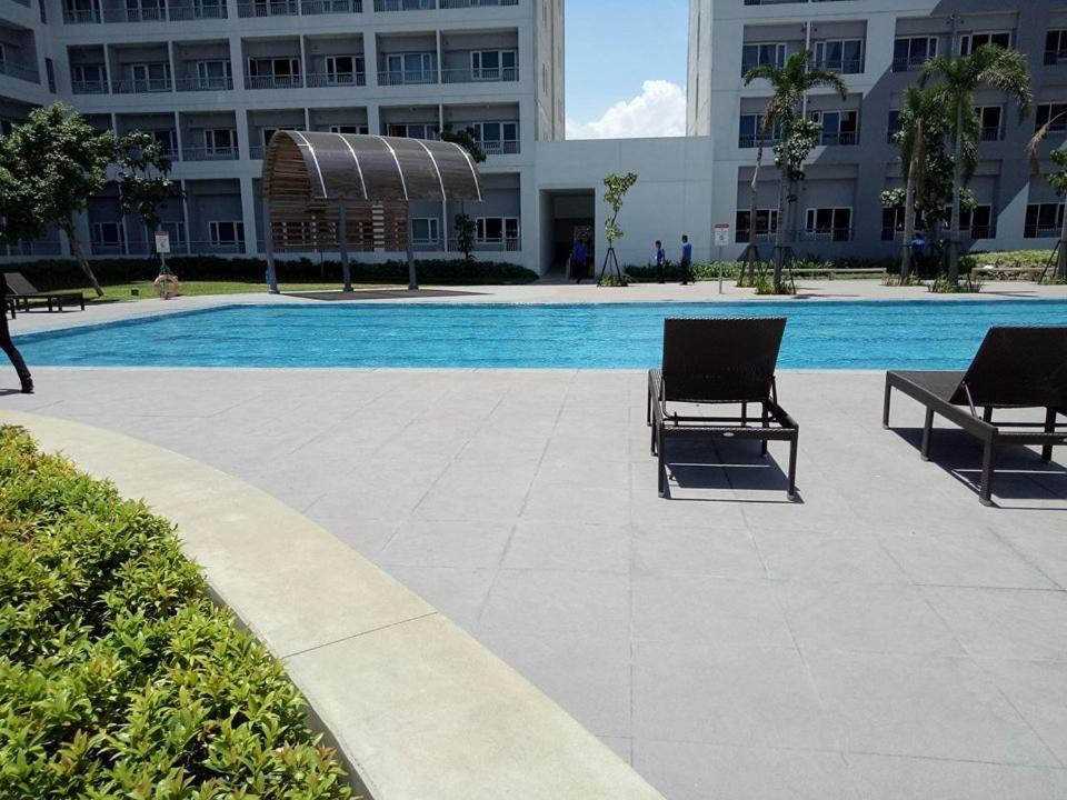 The swimming pool at or near Grace By H & M Condotel