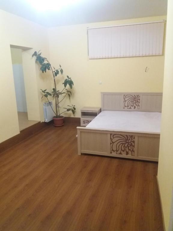 Кровать или кровати в номере Студийный дом