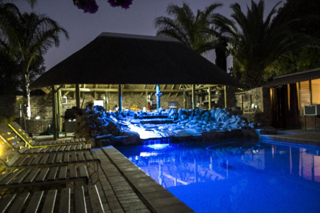 The swimming pool at or near Aan die Oewer Guesthouse