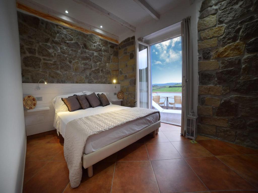 Postelja oz. postelje v sobi nastanitve La Roccia Dell'Elefante